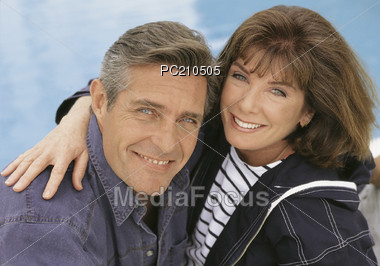 Mature Couple in Happy Embrace Stock Photo