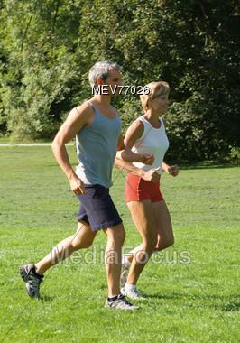 Mature Couple Jogging Stock Photo