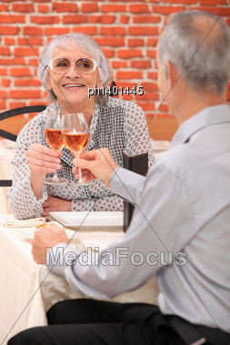 Mature Couple Toasting With Rose Wine Stock Photo