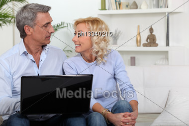 Mature Couple With Computer Stock Photo