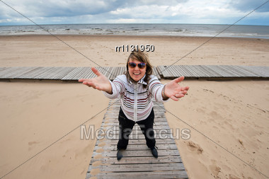 Mature Funny Attractive Woman In Sunglasses Relaxing At The Baltic Sea In Autumn Day Stock Photo