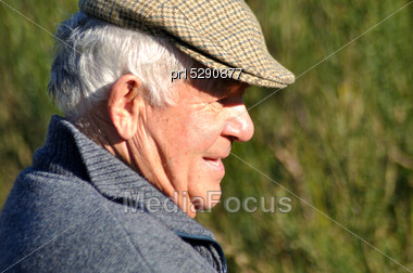 Mature Hunter Looking For Game Stock Photo