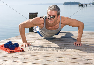 Mature Man Doing Push-ups Stock Photo