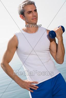 Mature Man Weightlifting Stock Photo
