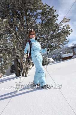Mature Woman Doing Snow Board Stock Photo