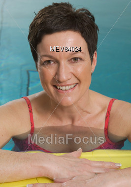 Royalty-Free Stock Photo: Mature Woman in Pool