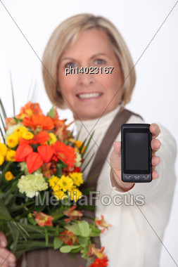 Mature Woman Showing Mobile Phone Stock Photo