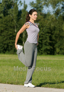 Mature Woman Stretching Stock Photo