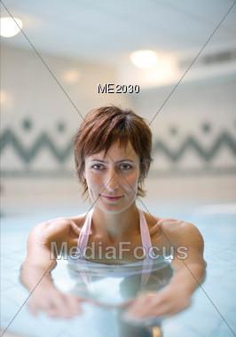 Mature Woman Swimming Stock Photo