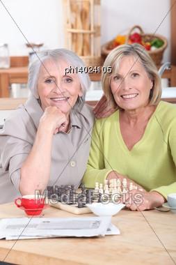 Mature Women Playing Chess Stock Photo