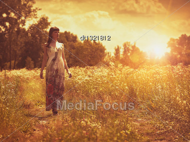 On The Meadow, Female Portrait Under The Evening Sun Stock Photo