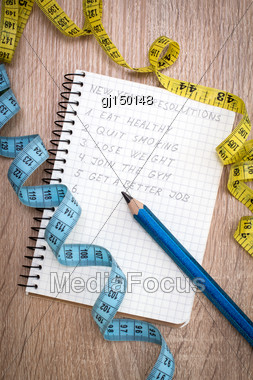Measure Tape And Notepad With New Year's Resolutions Stock Photo
