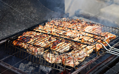 Meat Cooking In The Barbecue, High Resolution Stock Photo