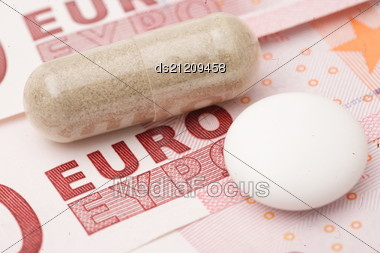 Medical Red Pills And Money Close Up Stock Photo