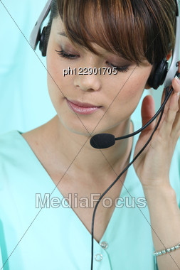 Medical Secretary With Headset Stock Photo