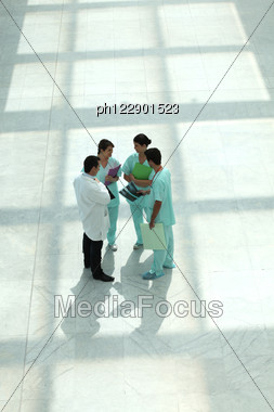 Medical Team In An Atrium Stock Photo