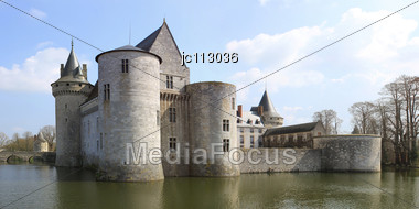 Medieval Castle With Its Moats, Towers And Dungeon Stock Photo