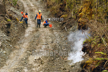 Men Setting Off Explosive Charges In A Seismic Reflective Survey Looking For Oil On The West Coast Of New Zealand Stock Photo