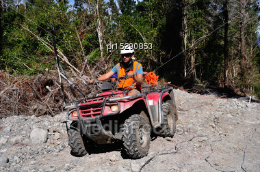 Men Use An All Terrain Vehicle For Setting Out Cables In A Seismic Reflective Survey Stock Photo
