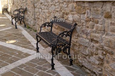 Metal Weaving Benches Near Ancient Walls In Italian Town CINGOLI Stock Photo
