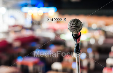 Microphone On Stage In Club With Bokeh Background Stock Photo