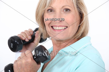 Middle Age Woman Lifting Weights Stock Photo