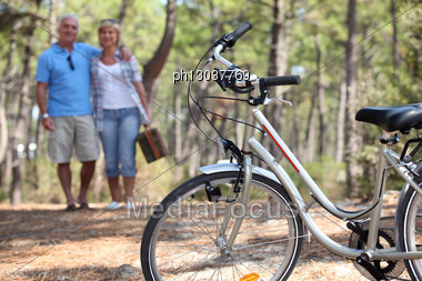 Middle-aged Couple Cycling Stock Photo