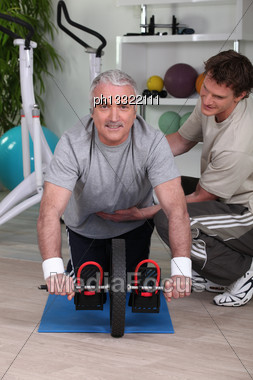 Middle-aged Man Working With Personal Trainer Stock Photo