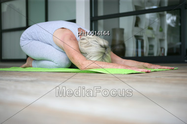 Middle-aged Woman Doing Yoga Stock Photo