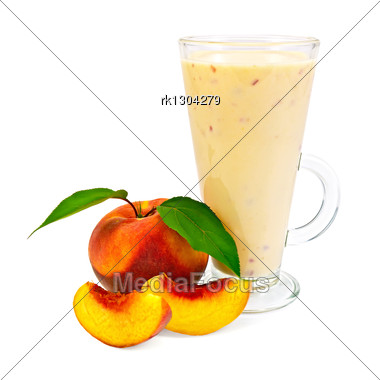 Milkshake In A Glass With Peaches And Green Leaves Stock Photo