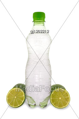 mineral water and a green lemons Stock Photo