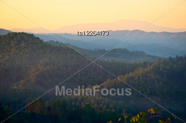 Mist In The Mountains At Sunset In Northern Thailand Stock Photo