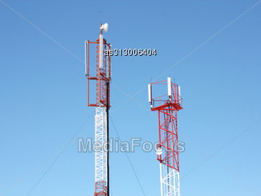 Mobile Telecommunication Technology Antenna (radio Antenne) For Wireless Mobile Phone Connections On Blue Sunny Sky. Electrical Wireless Equipment Concept Stock Photo