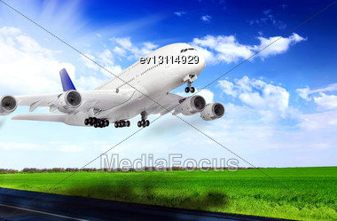 Modern Airplane In Airport. Take Off On Runway Stock Photo