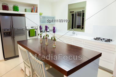 Modern Design Kitchen With White And Wood Elements Stock Photo