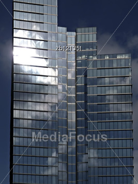 Modern Glas Building Against Clear Blue Sky With Sun Reflection In Windows. Stock Photo