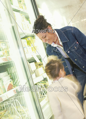 Mom and Daughter Grocery Shopping Stock Photo