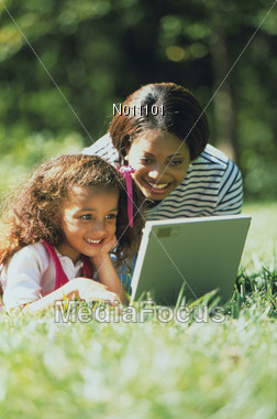 Mom and Daughter with Laptop Stock Photo