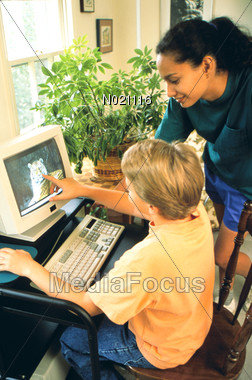 Mom and Son at Computer Stock Photo