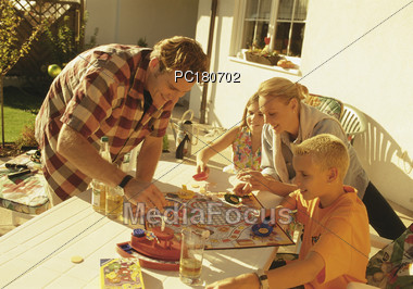 Mom and Dad Playing Game with Kids Stock Photo