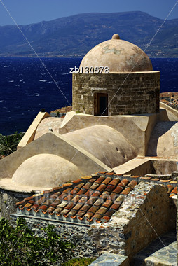 Monemvasia Is A Powerful Medieval Fortress Town In Greece Located On A Small Peninsula Off The East Coast Of The Peloponnese Linked To The Mainland By A Short Causeway. The Town Walls And Many Byzanti Stock Photo