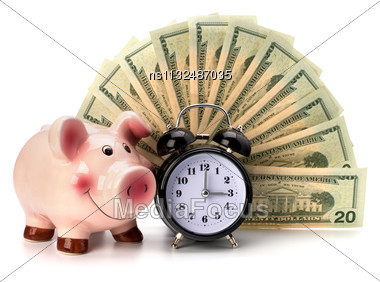 Money Accumulation Concept. Money And Alarm Clock Isolated On White Background Stock Photo