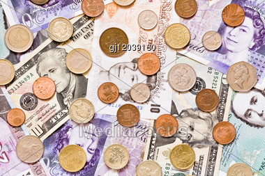 Money Background Made From A Different Currencies Stock Photo