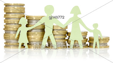 Money Concepts. Paper Family And Stacks Of Coins On White Background Stock Photo
