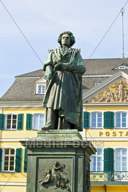 Monument Of Ludwig Van Beethoven On Background Of Post Building In The Center Of Bonn, Germany Stock Photo