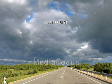 Most Asphalt Road, Against The Background Of Clouds Stock Photo