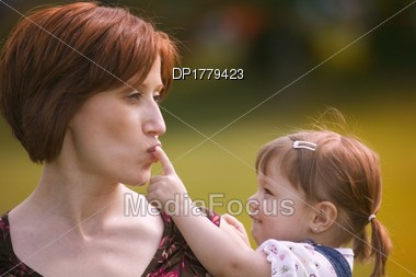 Mother And Child Play Together Stock Photo