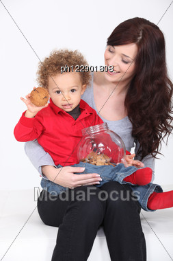 Mother And Child With Cookie Jar Stock Photo