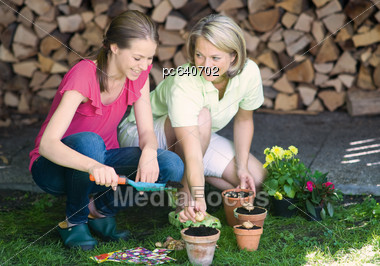 Mother And Daughte Gardening Stock Photo