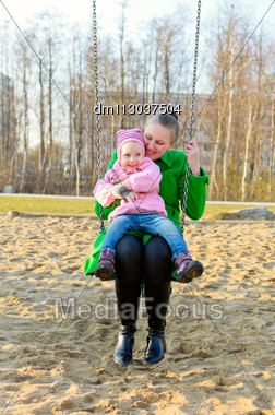 Mother And Daughter On A Swing Stock Photo